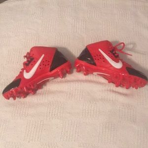 Red and black football cleats.